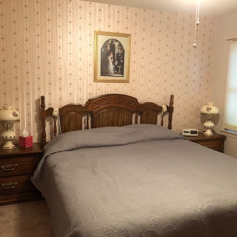 Bedroom one with a king size bed and a heated air mattress with dual controls