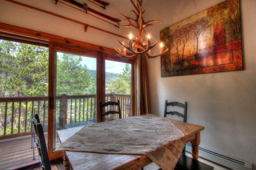 Dining Area & Private Deck - Spacious Dining area that seats 6. Enjoy your coffee or lunch on the large outdoor deck that is surrounded by mature trees and overlooks the Snake River and the mountains of the Continental Divide.