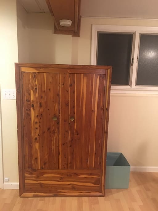 Extra closet space and smoke alarm by the bed.