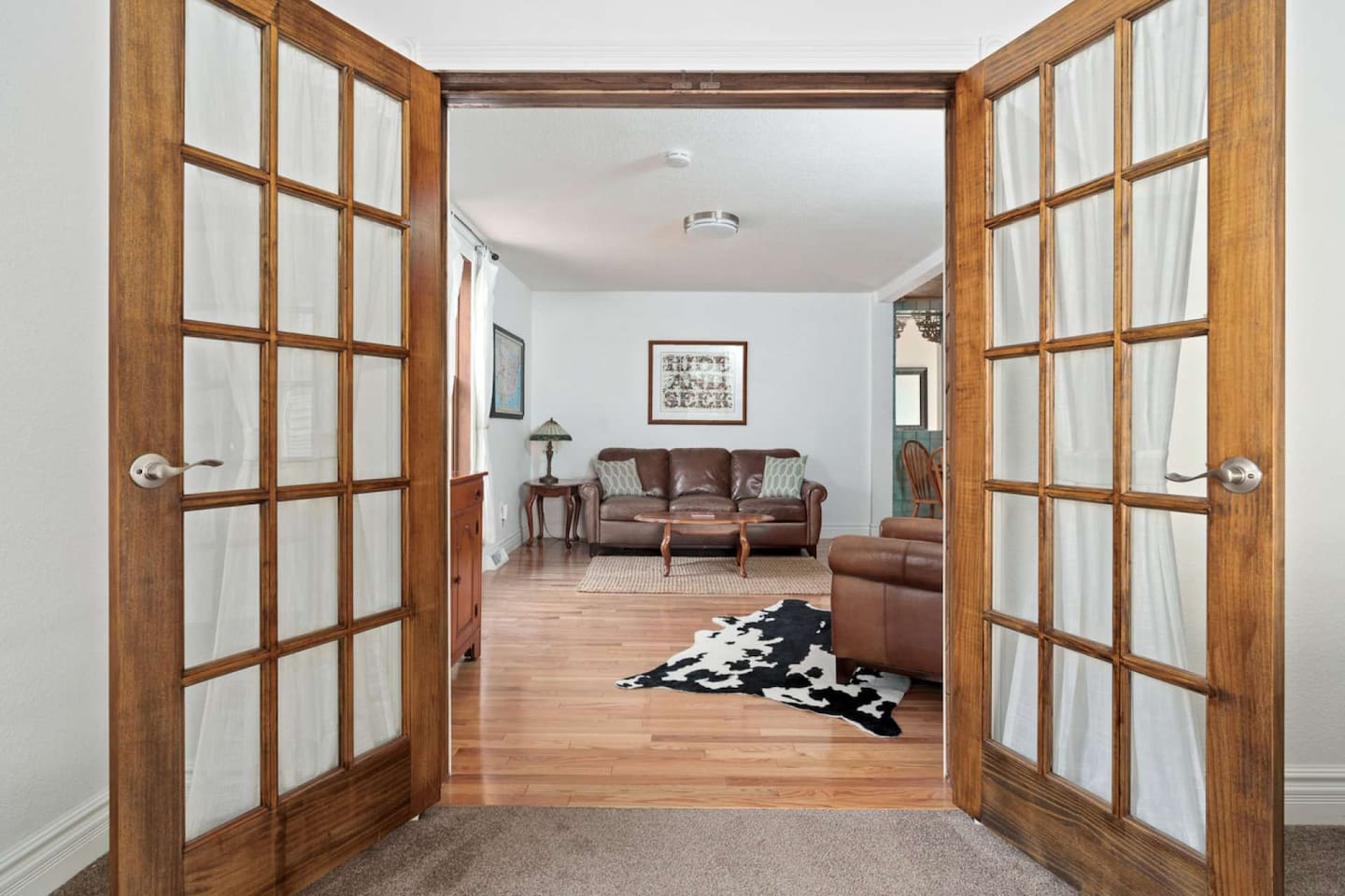 Come right in! Cozy, living room space located off the kitchen & between two bedrooms, perfect for recharging after a day of exploring.