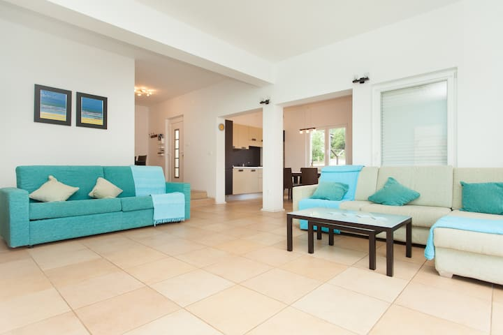 Open plan living space with kitchen/ dining area and hallway.