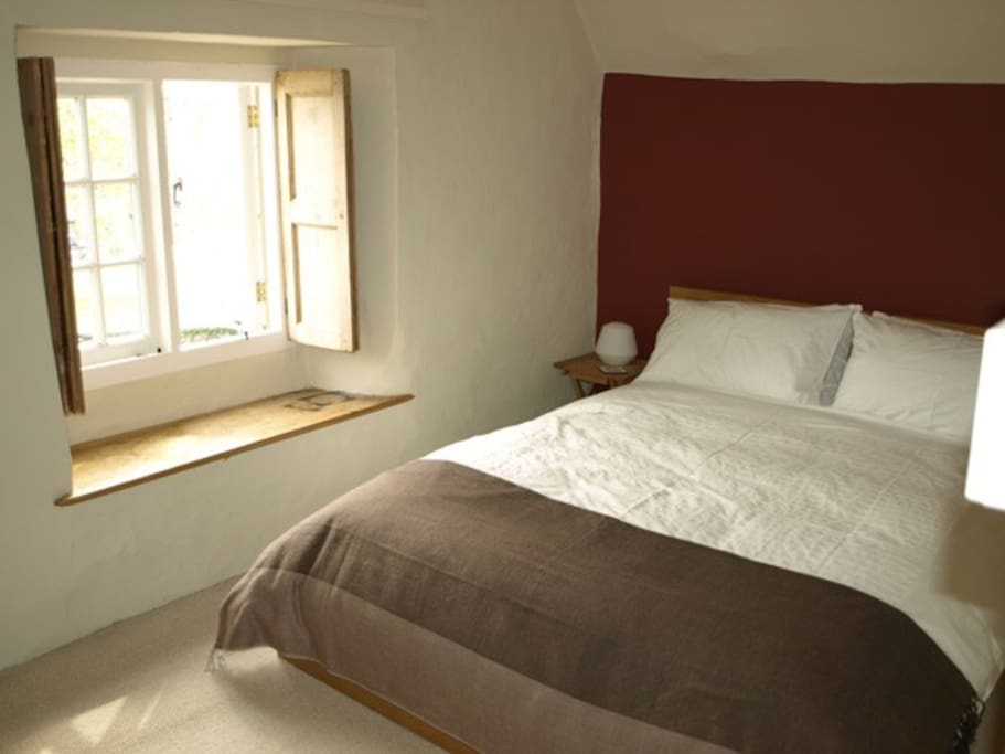 Double bedroom with window shutters and views over The Square