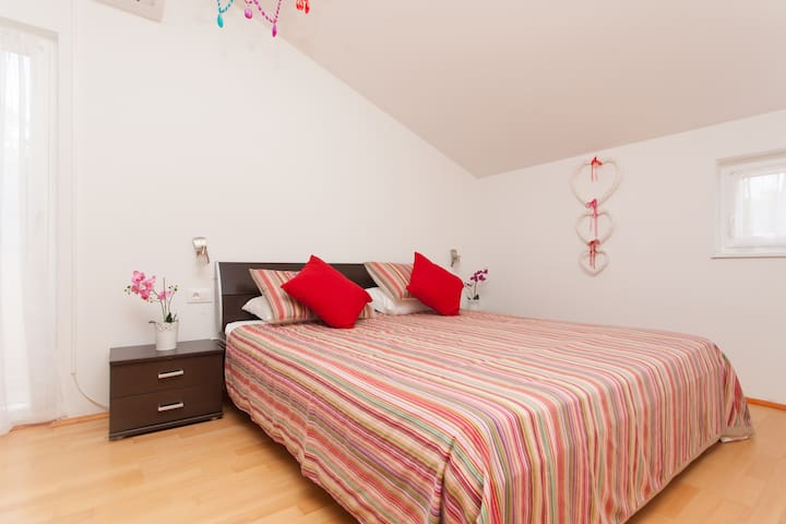Superking bed with wall to wall wardrobes and walk out balcony