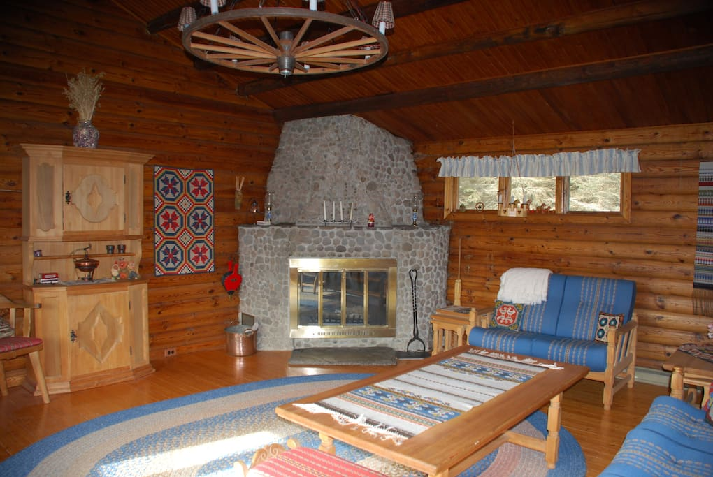 Cozy living room with fireplace, spectacular mountain views form a large picture window, and a television!