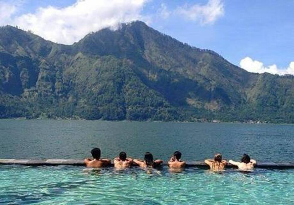 After trekking to mount batur you can relaxing with hot spring with beautiful abang hill