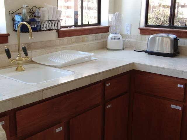 Toaster and blender add to the kitchen amenities. Fully equipped with all cooking utensils needed.