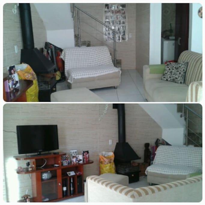 sala de estar com lareira, tv a cabo, hi-fi, lavanderia com maquina de lavar roupas.