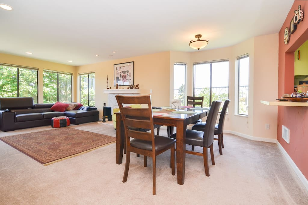 Large open living room and dining room with lots of natural light.