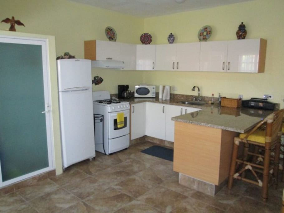 Fully equipped granite/acrylic kitchen with EVERYTHING included (blender, coffeemaker, toaster, crockpot, microwave, linens, etc.).
