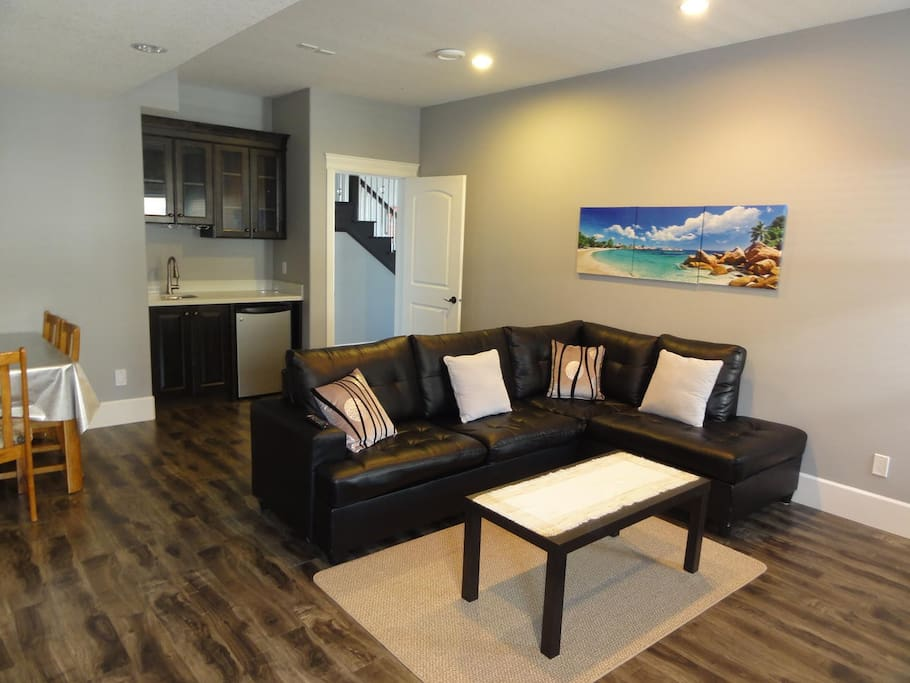 Private lounge in the guest suite with wet bar and fridge