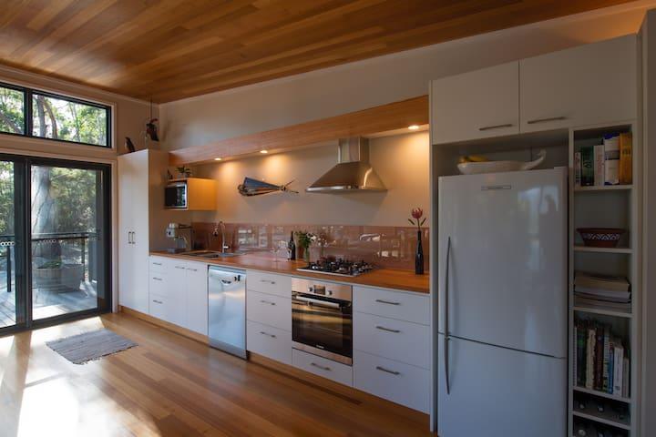 Full kitchen plus outdoor Weber bbq.