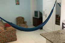 Sala de estar...com rede  e violao para uso