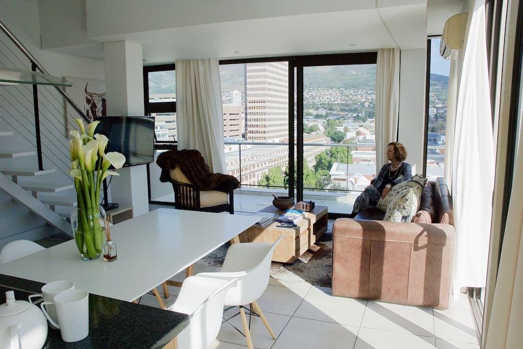 Light open beautiful apartment with wrap around balcony and amazing views over Table Mountain and the City.