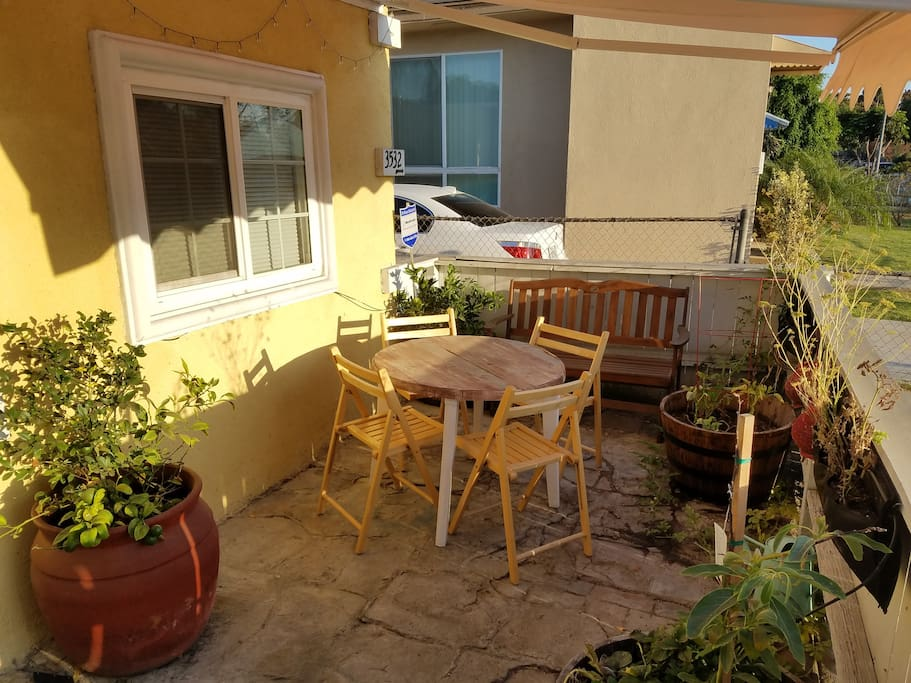 Retractable awning. Provides pleasant hangout spot, especially in the morning.