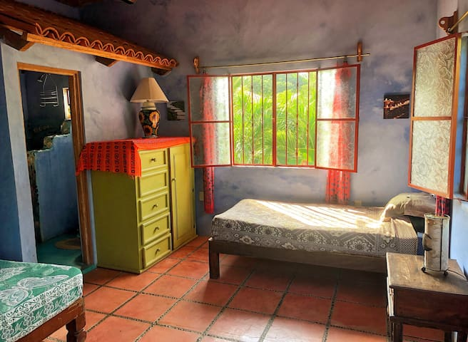 Casita Danza, bedroom two on the right. It features a matrimonial or double-sized bed and an individual or single-sized bed.