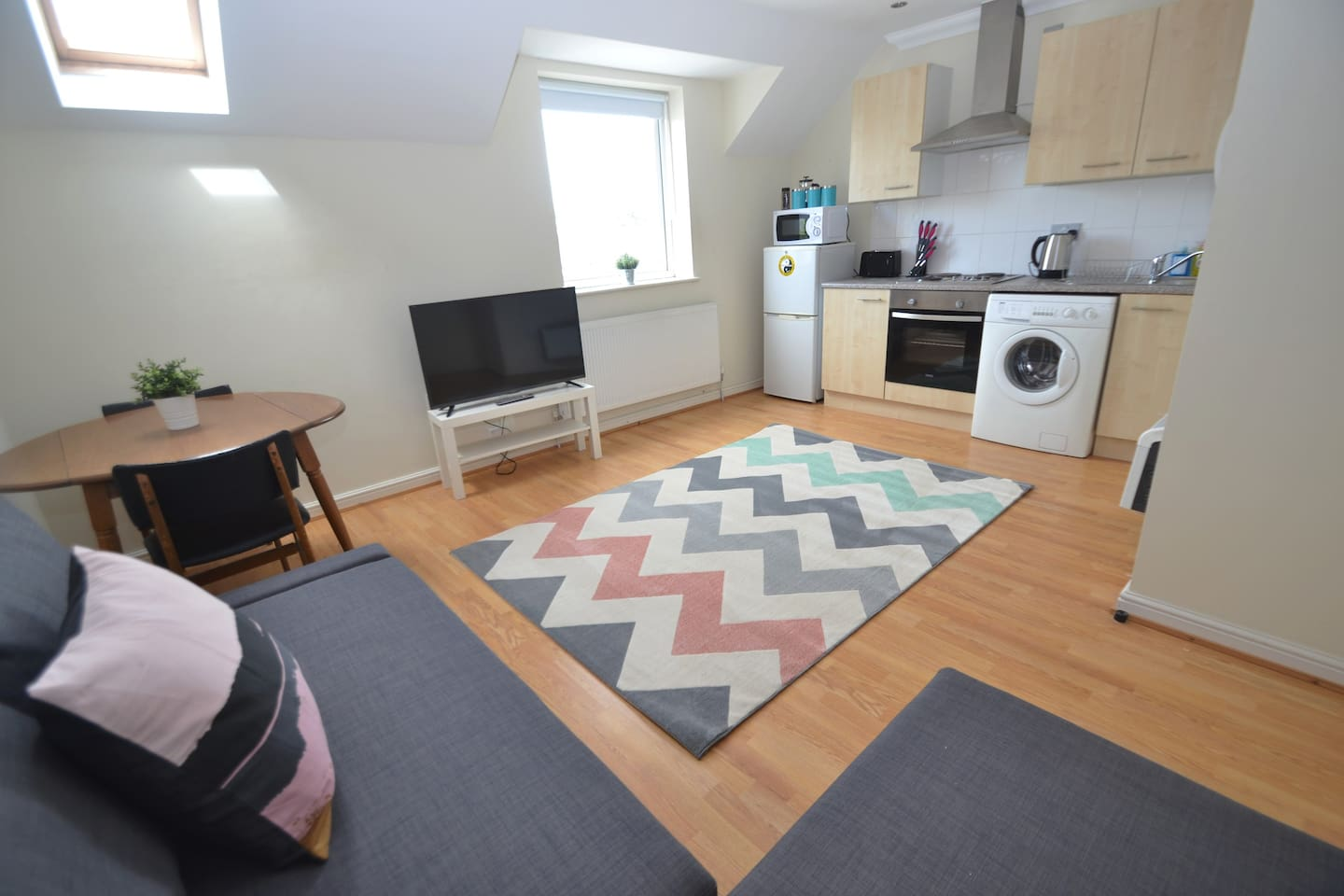 Spacious kitchen dining room with comfy double sofa bed