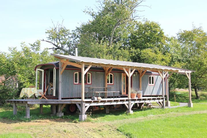 wooden caravan on organic farm