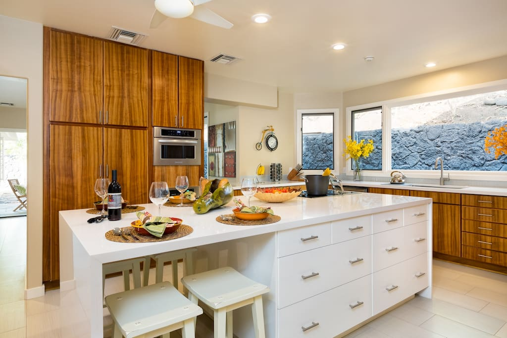 Our newly remodeled kitchen has stunning koa wood cabinets, and a waterfall white quartz counter.