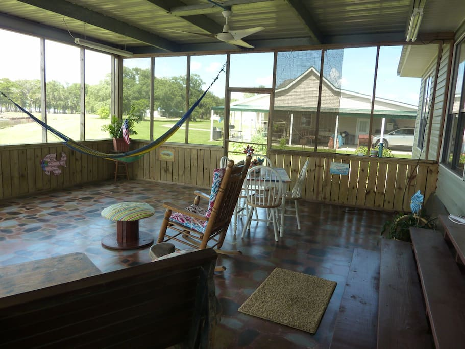 The large screened in porch to enjoy the scenic view