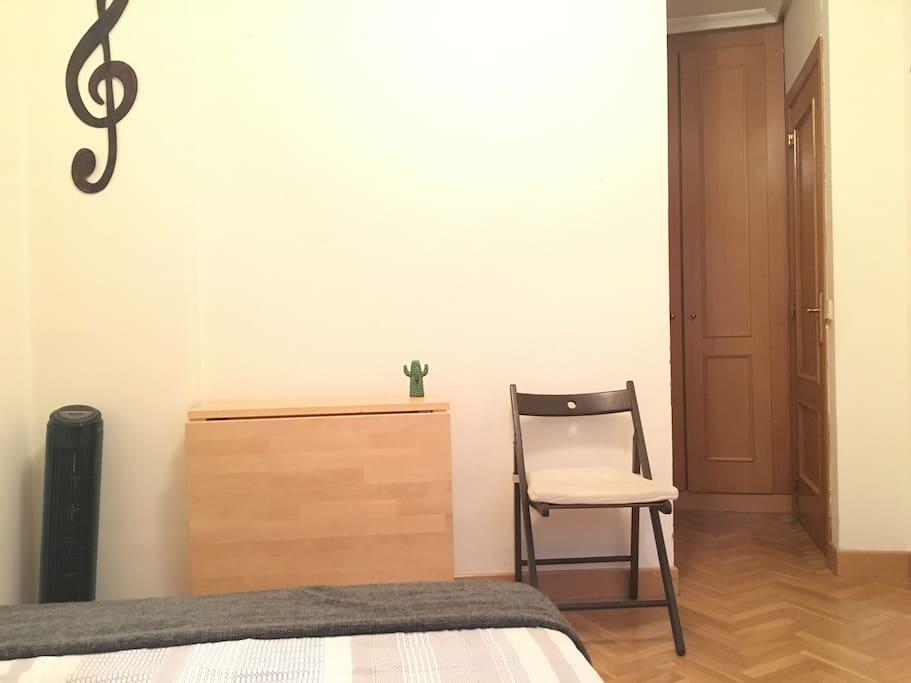 Bedroom + closet + table + fan