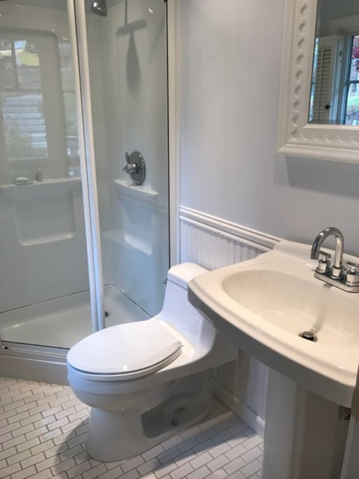 The master bath has a new tile floor and shower. Bath and beach towels are provided. There is an outdoor shower off the deck.