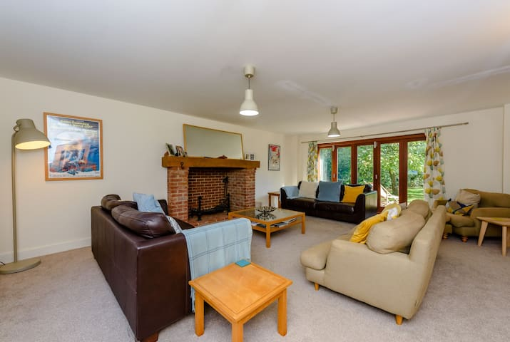 Main living room, opening out onto decking and gardens