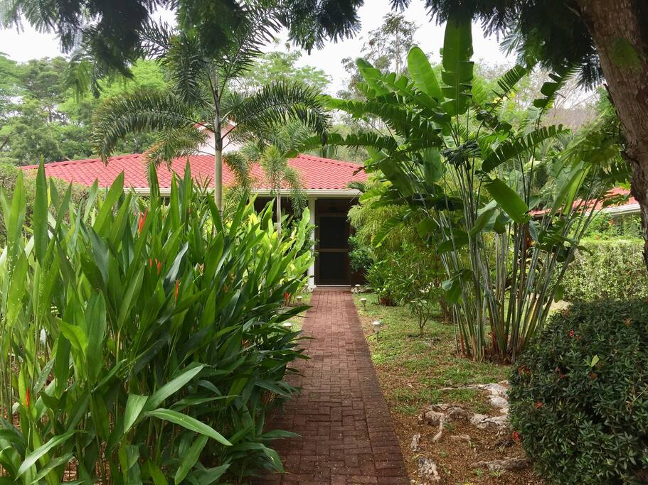 Beautiful garden greets you at entry.
