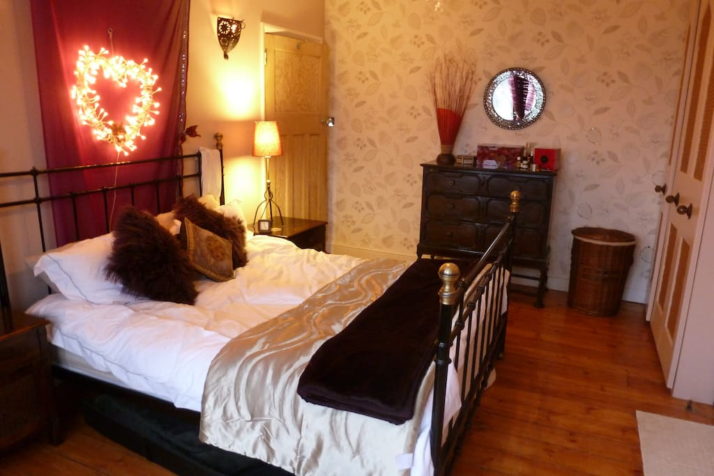 Master  Bedroom , King sized bed, 2 large wardrobes , and view of Garden.