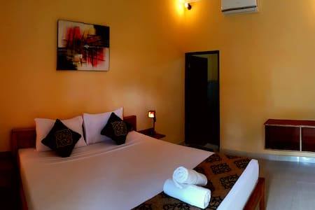 Suba Deluxe Room with AC - Mushroom Bay Beach - Bungalo