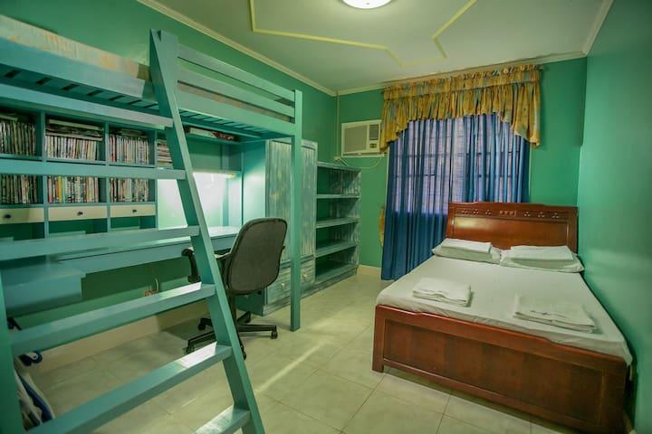 Villa Bedroom Queens bed plus single bunk bed