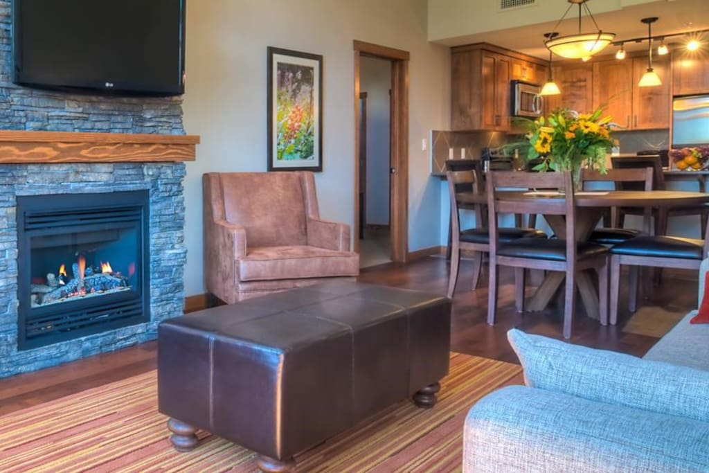 Relax in front of the flatscreen TV and fireplace in the beautiful living area