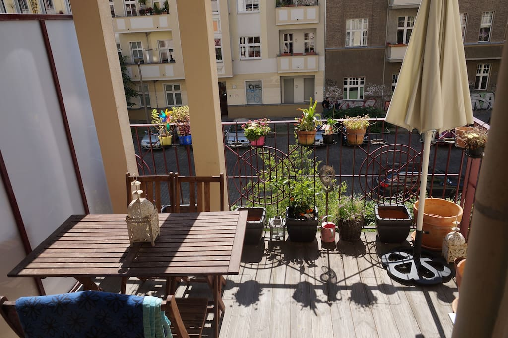 Sunny, spacious balcony with parasol
