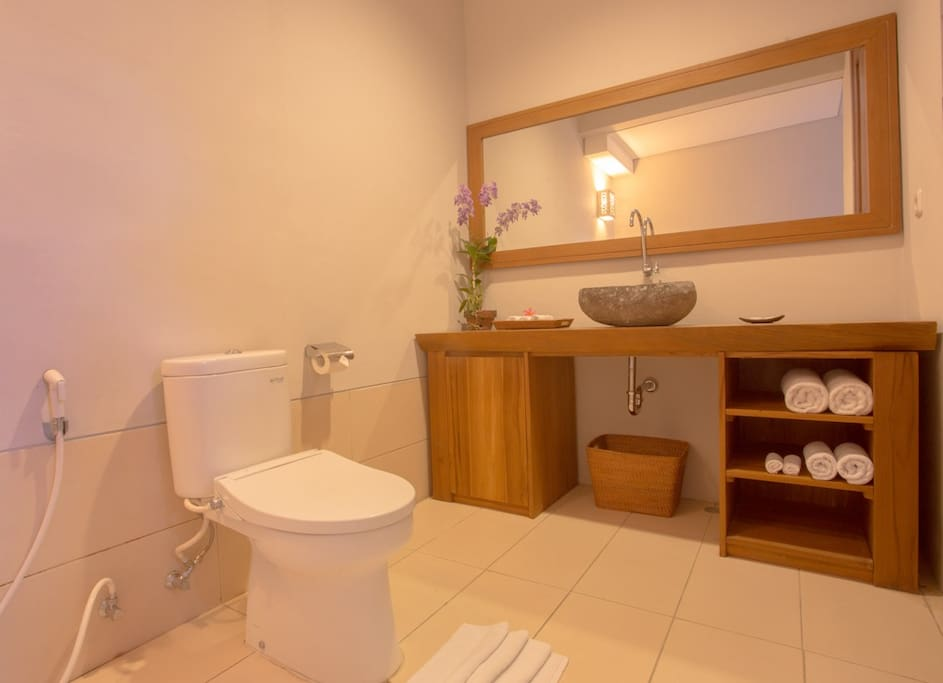 Your private spacious bathroom with amenities, towels and hot & cold water for shower.
