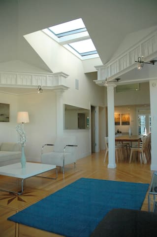 Dining room featuring vaulted ceiling and large skylight