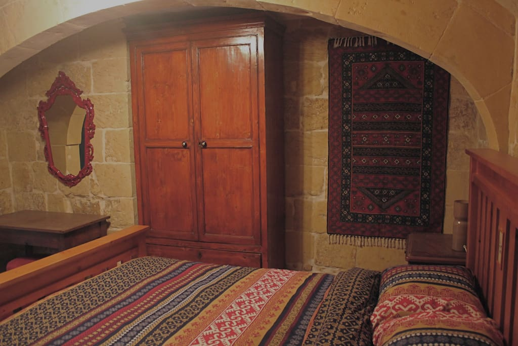 There is also a wardrobe, desk, stool and chair.