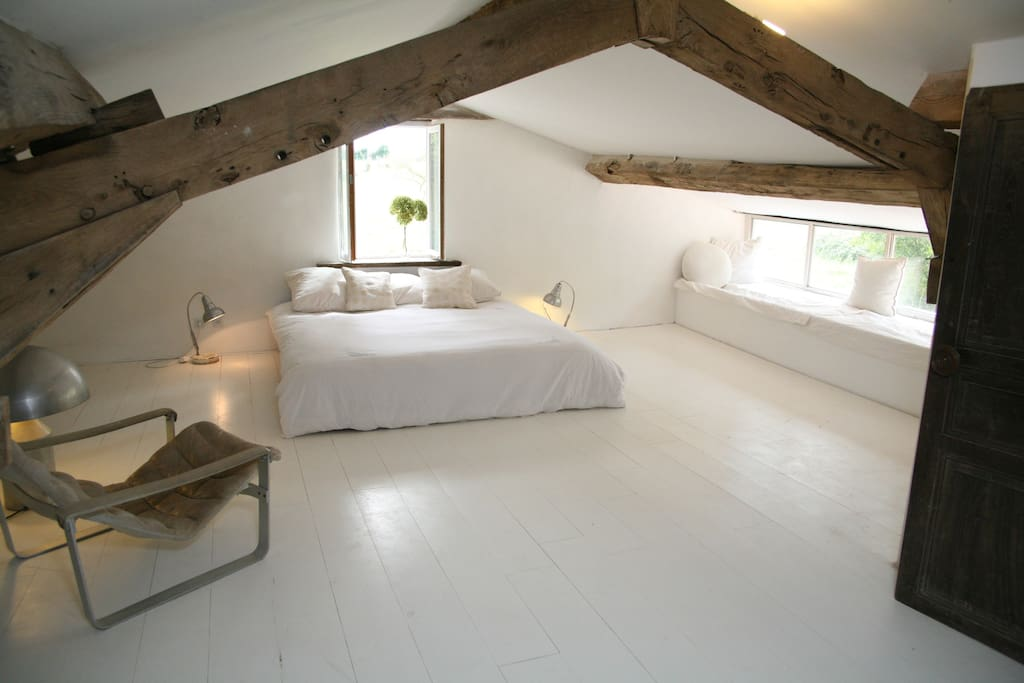 The very calm and peaceful double bedroom leading onto -