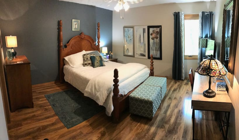 Master bedroom, 13'x13', queen Tempurpedic memory foam mattress, dresser, nightstand, desk, closet, ceiling fan. Large window with view of the woods. Attached bathroom w/single sink, shower stall, toilet.