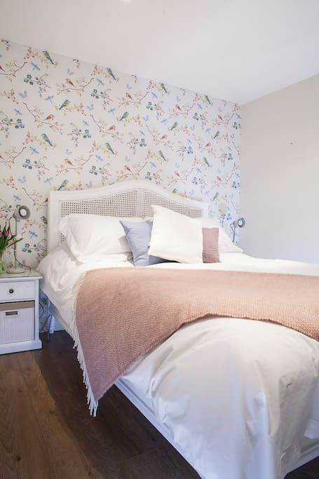 Crisp white bed linen and a feather duvet await!