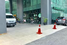 Starbucks is just at the ground of the building