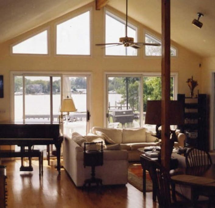 Living room with expansive water views and grand piano