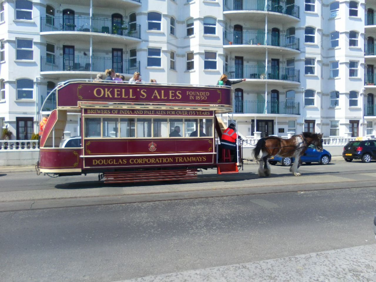 FRONT VIEW OF THE  APARTMENT WITH HORSE TRAM