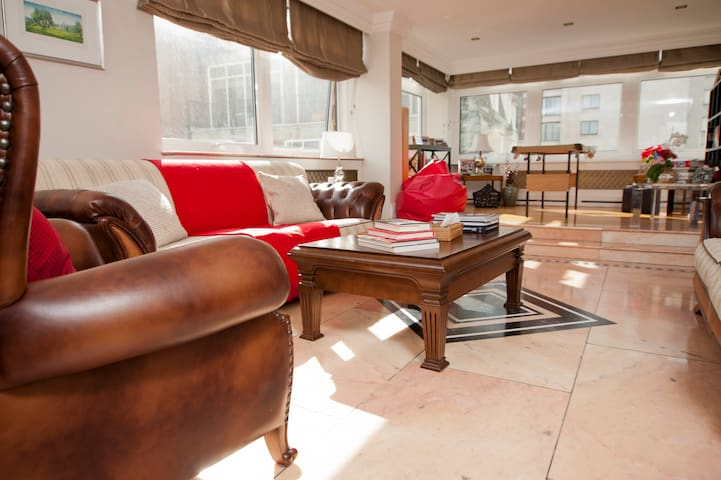 Living room with views towards Hyde Park and the rooftops of Mayfair