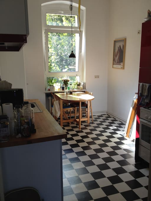 The kitchen is bright and cheerful, with all conveniences