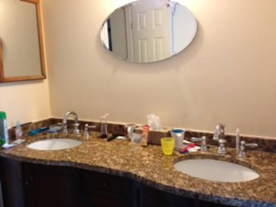 Double sink vanity with granite countertop