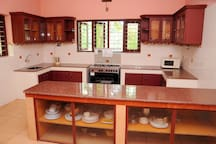 Well stocked kitchen with counter top and modern amenities
