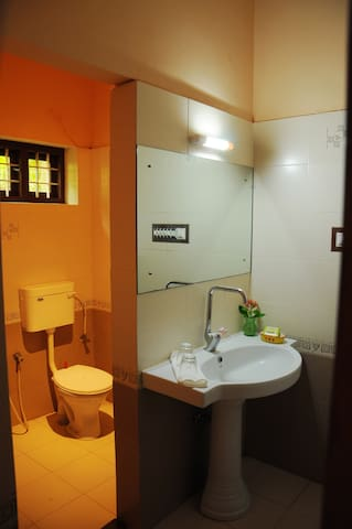 Wet and dry split bathrooms with separate dressing area attached to both bedrooms. Hot and cold shower facility in each