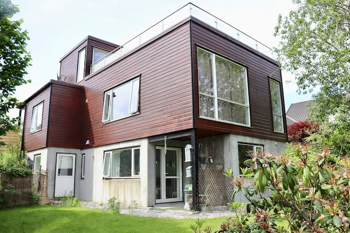 STORD. Modern flat with private garden