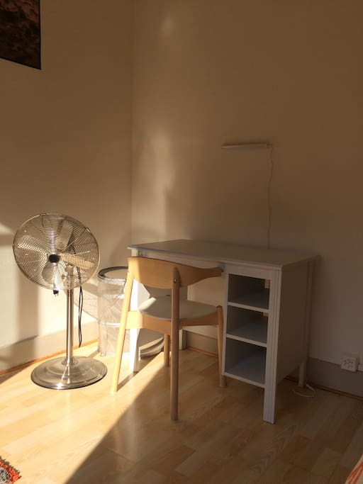 There is a desk, a fan for hot days and a laundry basket for those who stay longer.