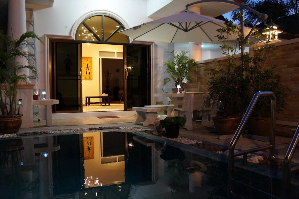 Pool and den at night