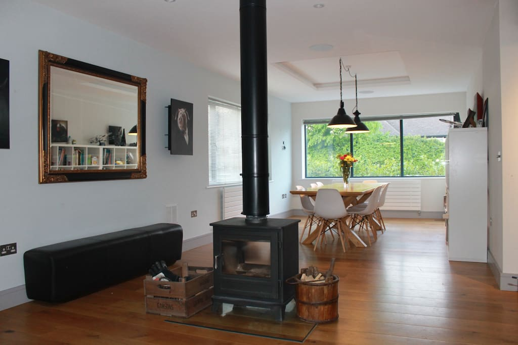 Open plan dining and games area with wood fire